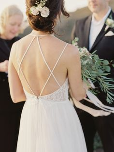 Criss cross lace wedding dress: http://www.stylemepretty.com/2017/03/11/oceanside-destination-elopement/ Photography: Michele Beckwith - http://michelebeckwith.com/