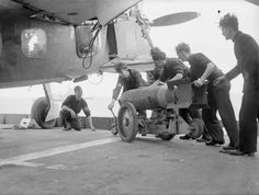"""Placing a pounds bomb, in the ventral cargo point of a Fairey """"Barracuda"""" torpedo/dive bomber, in the flight deck of the british armoured aircraft carrier HMS """"Formidable"""", on July, Ww2 Aircraft, Aircraft Carrier, Thing 1, Flight Deck, Military Men, Royal Navy, Troops, Wwii, Aviation"""