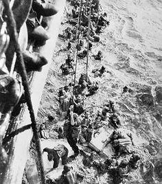 Survivors of German battleship Bismarck being pulled aboard heavy cruiser HMS Dorsetshire, 27 May 1941. (Imperial War Museum)