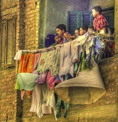 This reminds me of the short time I lived in Cairo, my hostess with the mostess and friend A. hanging the family laundry off the balcony. <3