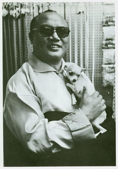 HH the 16th Karmapa holding a chihuahua
