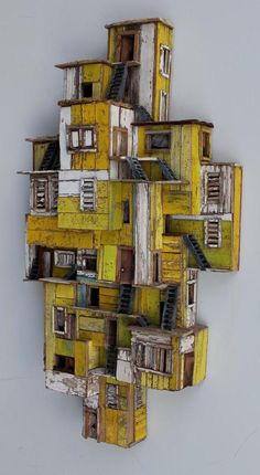 Eric Cremers – Shades of yellow – Eric Cremers – Shades of yellow – - Assemblage Art Sculptures Céramiques, Wood Sculpture, Karton Design, Cardboard City, Architectural Sculpture, Driftwood Art, Assemblage Art, Miniature Houses, Shades Of Yellow