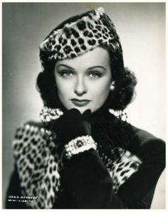 Joan Bennett sports a leopard print hat and matching jacket.