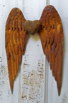Rusty metal detailed wings wall sculpture shabby chic rusty industrial farm house home decor Anita Spero