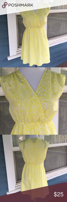 "KARDASHIAN KOLLECTIION Yellow Dress Pretty💛KARDASHIAN KOLLECTION Yellow Dress.  Sleeveless. Vneck.   Elastic gathered waist.  Yellow &white animal print polyester material.  Pit-to-pit 18"".  Waist 27"" (unstretched).   Length 31"" (shoulder to hem).   Excellent condition. Kardashian Kollection Dresses Mini"