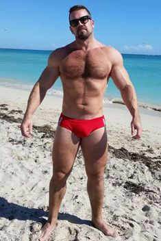Muscular, Built, Bearded Beef - Packed into a red Speedo brief.