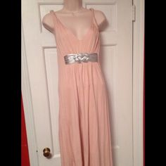 Manoush Designer Dress. NWOT. Never worn.Pristine From high end designer Manoush,  comes this gorgeous dress in a lovely pink .  Manoush brilliantly adds a touch of silver which beautifies this elegant dress . Grecian style rolled rope begins @ the neckline & continues around to  the mid area  of the back. Dress has double layers of material, therefore, no slip is needed!  If you're looking for a unique summer romantic dress~~~THIS IS THE ONE !  Brand new, never worn. Pristine condition…