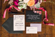 black + white with purple acent calligraphy invitation