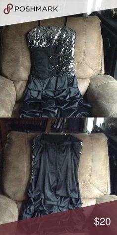 Homecoming dress Black dress with sequins and the bottom has a small bustle. Very cute on. Worn once. Deb Dresses Prom