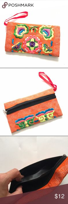"""🔥BOGO🔥New Orange Handmade Embroidered Wristlet New Orange Handmade Embroidered Wristlet measures 4.5"""" x 8.5"""" with black 2 pocket lining and front zipper closure.   Bag is handmade but machine embroidered and brand new from manufacturer.  Bag color is consistent, design and embroidered colors may vary slightly from pictures shown.  Perfect for night out or day Purse or a makeup bag or pencil case.  Multiple colors listed. Great gift idea! Handmade Bags Clutches & Wristlets"""