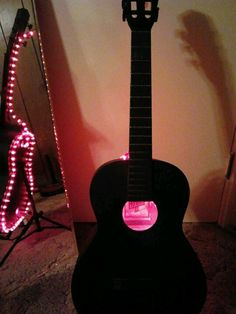 Guitar Lamp painted flat black with red rope lights.