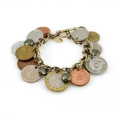Great idea!  Make a charm bracelet out of coins from all the places you've traveled to.