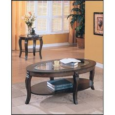 Acme 00450A Riley Glass Top Oval Coffee Table, Walnut Finish  Riley #oval #coffee #table comes with glass top. Made in china. This product weighs 34-pound. Available in walnut finish. Measures 50-inch length by 30-inch width by 18-inch height.