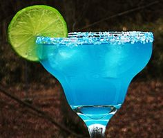 Moonlight Margarita (2 oz. Tequila 1 oz. Blue Curacao 2 oz. Sweet & Sour Mix 1 oz. Lime Juice 1 Tbs. Simple Syrup)