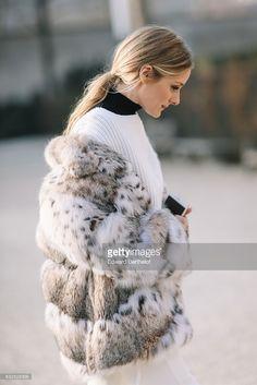 Fotografia de notícias : Olivia Palermo wears a fur coat, a white top,...