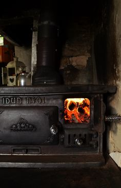 old cast iron stove ~ *Levida Lodge has a wood burning stove.