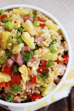 Hawaiian Fried Rice  Print Prep time 10 mins Cook time 20 mins Total time 30 mins  Fried rice that is loaded with sweet pineapple, ham and veggies that is so much better than take out! Author: Alyssa Serves: 6-8 Ingredients 1½ cups- 2 cups chopped ham 1 small white onion, chopped 1 red bell pepper, seeded and chopped 1 Tablespoon Vegetable Oil 3 eggs, lightly beaten 3 cups cooked rice 1 cup pineapple tidbits 1 Tbs sesame oil 2-3 Tablespoons soy sauce (more or less to taste) 2 Tbsp chopped…