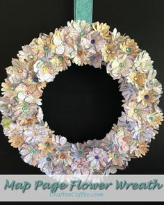 Map Flower Wreath: Beautiful wreath made with an old map, flower punches and Styrofoam wreath. Tutorial on CraftsnCoffee.com.