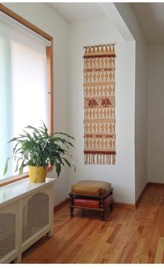 70s woven wall hanging with stackable footstools. thehouseofpancakes.com