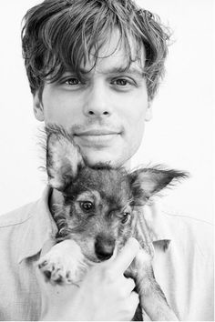 Matthew Gray Gubler.   That's below the belt to add the puppy to this picture!