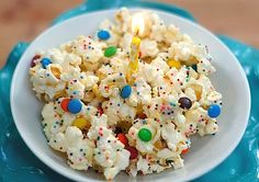 CAKE BATTER POPCORN 1 bag of microwave popcorn, popped 8 ounces of white almond bark 4 T of yellow cake mix mini M assorted colorful sprinkles