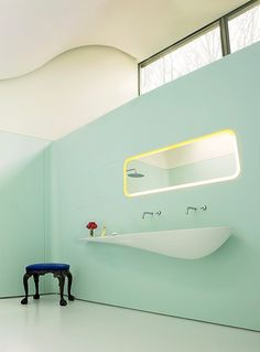 A pale blue open master bath designed by the architect Amanda Levete features a black George I Claw and Ball stool (c. 1720). Photographed by Simon Upton, Vogue, May 2011.
