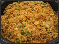 I could eat fried rice a week!Easy fried rice, better than takeout! 3 cups cooked white rice (I'll use brown) 3 tbs sesame oil 1 cup frozen peas and carrots (thawed) 1 small onion, chopped 2 tsp minced garlic 2 eggs, slightly beaten cup soy sauce I Love Food, Good Food, Yummy Food, Tasty, Asian Recipes, Healthy Recipes, Ethnic Recipes, Healthy Foods, Delicious Recipes