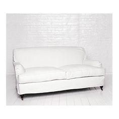 White slip covered sofa