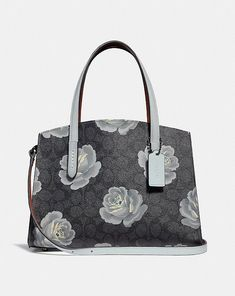 befb3ce7a Coach Charlie Carryall 28 in Signature Rose Print Coach Handbags, Luxury  Bags, You Bag