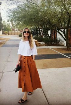 A rust midi skirt is on trend for spring