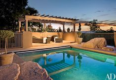 Rustic Pool by Rose Aiello and A & E Stoneworks in Santa Fe, New Mexico