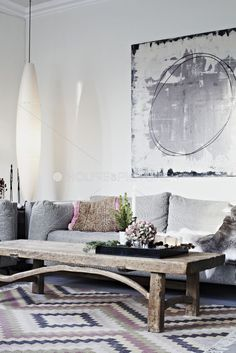 I love the contemporary look, and then that rustic coffee table! Terresa@baublesbythebay