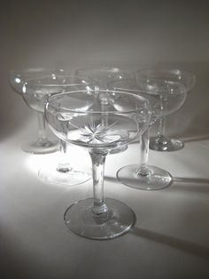 Perfect wedding gift - a set of 10 gorgeous, etched champagne coupes. Perfect for a champagne toast or for your gorgeous holiday cocktails.  Could ship before Christmas.