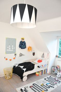 Black and white with pops of bright colour - a gorgeous boys room