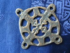 Siberia, Mongolia or Tibet.  Age: 30 -100 years approx  Height: 77mm (3.1 inches) approx An unusual and unique bronze cross-shaped shamanic amulet. A cross like this represents the four quarters of the world - a powerful universal shamanic symbol. In Siberian shamanism objects like this would be worn or tied to a shamans coat or other object.