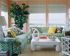 A Colorful Hamptons Home of The Beards' by architect Kelly F. Faloon and decorated by Chiqui and Nena Woolworth in Elle Decor.  Peach and green, green zebra couch. Fiddle leaf fig.