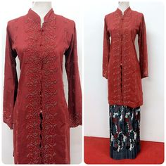 Make a space in your wardrobe for this beautiful long kebaya - it is fully beaded and comes with a pleated batik silk skirt. Shop now! Kebaya Hijab, Kebaya Dress, Batik Kebaya, Kebaya Muslim, Muslim Dress, Modest Fashion, Hijab Fashion, Fashion Dresses, Women's Fashion