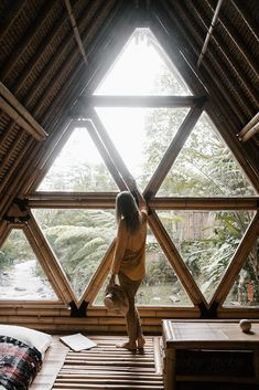 yang women, painter in the bamboo cozy house in the jungle by Nick Bondarev for . - yang women, painter in the bamboo cozy house in the jungle by Nick Bondarev for Stocksy United Infor - Jungle House, Forest House, A Frame Cabin, A Frame House, Cozy Cabin, Cozy House, Triangle House, Bamboo House, Tiny House Design