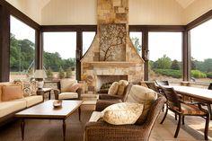 Atlanta, GA screen porch with masonry stone fireplace, stone flooring, cypress columns and tongue & groove ceiling.  Cardinal Construction, Inc. - Duluth, GA