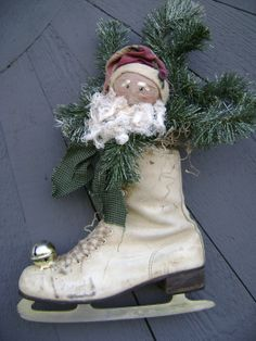 Vintage Ice Skate Primitive Paper Mache Santa by junquegypsy