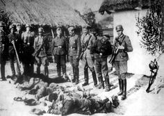Rzsow, Poland, German policemen next to the bodies of victims they had murdered.