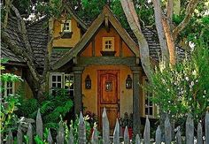 I straight up just want to live in this cottage. That fence is friggin' adorable! And the colors! The colors!