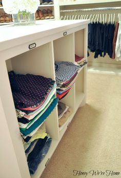 """Organized """"Boutique"""" Closet // Honey We're Home, cubicle storage in the island"""