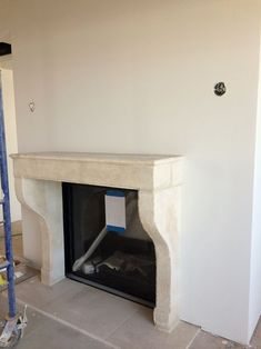 The antique French limestone mantel from Exquisite Surfaces has been installed in the living room!