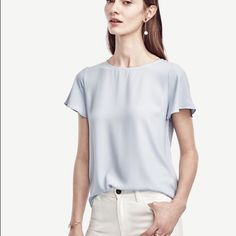 Ann Taylor Matte jersey flutter sleeve top Brand new. Tag off. Never wore. It is baby blue. A bit more blue than shown in picture Ann Taylor Tops Blouses