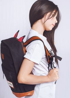 Get excited to go to work or school with this unique backpack. Made of canvas…