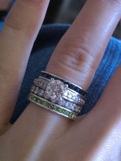 """birthstone band for each of my children, to wrap around my wedding ring. I love this"" I love her ring too"