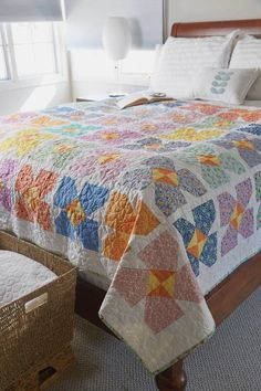 1930s reproduction prints give this bed-size quilt pattern a farmhouse vintage look, and the white background keeps it fresh. It fits perfectly on a twin bed or looks lovely folded at the bottom of a full or queen.1930s Bouquet, by Debra Finan, is available as a quilt kit while supplies last!