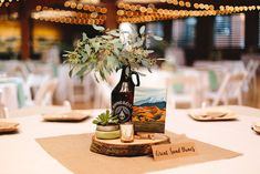 Photo by: Brooke Townsend Photography Painting of National Park by: Karen Obr. Wedding Shower Favors, Bridal Shower Decorations, Wedding Decorations, Wooden Slab Centerpiece, Party Centerpieces, Weeding Themes, Brewery Wedding, Reception Party, Wedding Seating