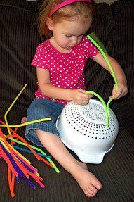 When your toddler is bored or you're trying to get something done, give her a colander and some pipe cleaners! Amazing how much fun this is for them!